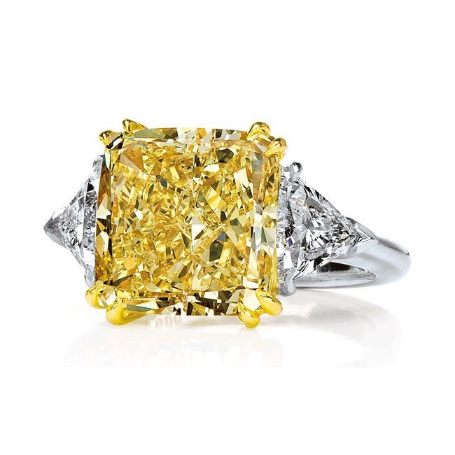 FANCY YELLOW RADIANT CUT DIAMOND WITH COLORLESS TRILLION CUT DIAMONDS CRAFTED IN 18K YELLOW GOLD AND PLATINUM, 6.39 CTW