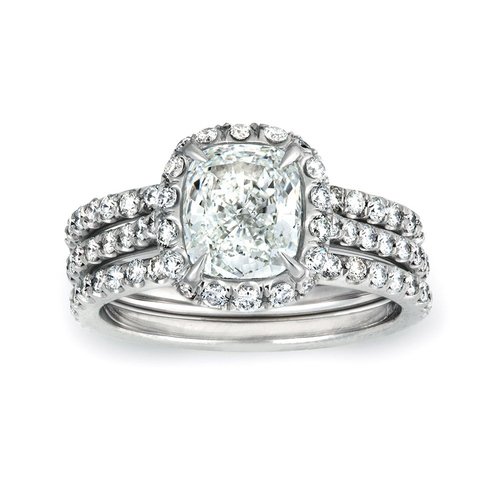 CUSHION CUT CENTER DIAMOND WITH MODERN CUT DOWN DIAMOND PAVE HALO, CRAFTED IN PLATINUM, 3.60 CTW, SHOWN WITH MATCHING BANDS