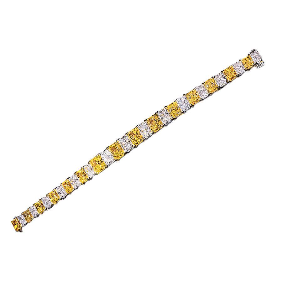 15 FANCY INTENSE YELLOW AND 15 COLORLESS RADIANT CUT DIAMOND BRACELET CRAFTED IN 18K AND PLATINUM, APPROXIMATELY 40 CTW