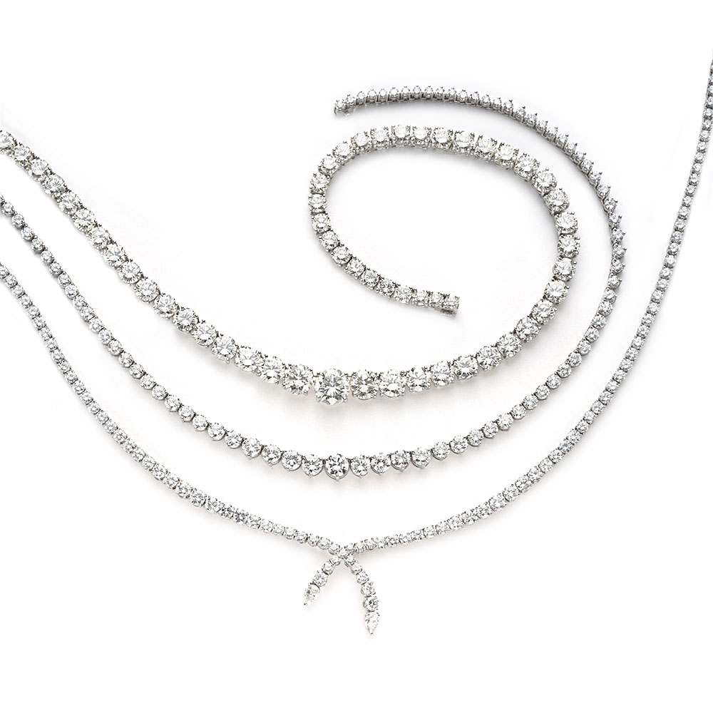 COLLECTION OF RIVIERA NECKLACES CONTAINING COLORLESS AND NEAR-COLORLESS DIAMONDS, SET IN PLATINUM, RANGING 20 TO 65 CTW