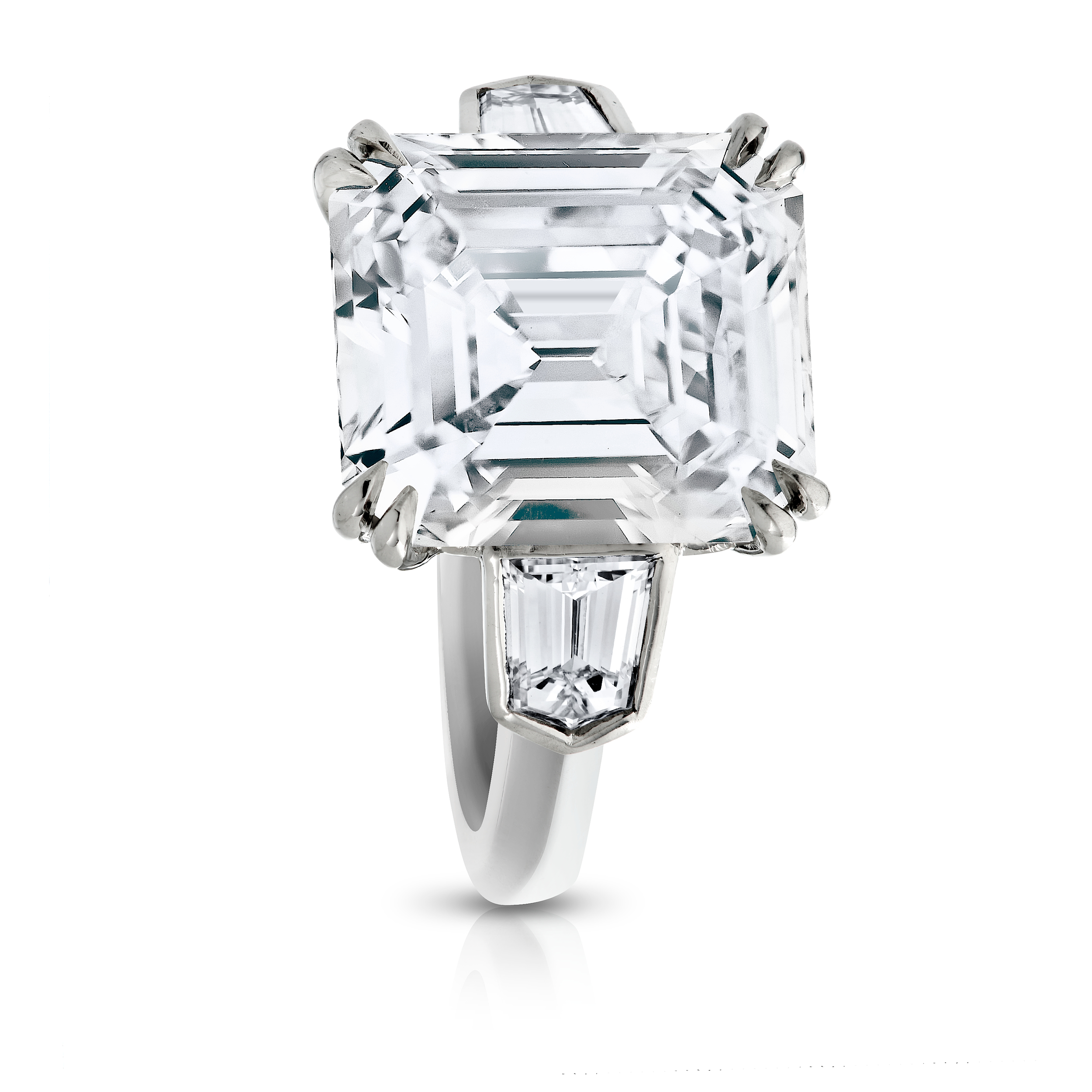 EMERALD CUT CENTER DIAMOND WITH SPLIT EAGLE CLAW PRONGS AND BEZEL SET BULLET CUT SIDE DIAMONDS CRAFTED IN PLATINUM, 7.11 CTW
