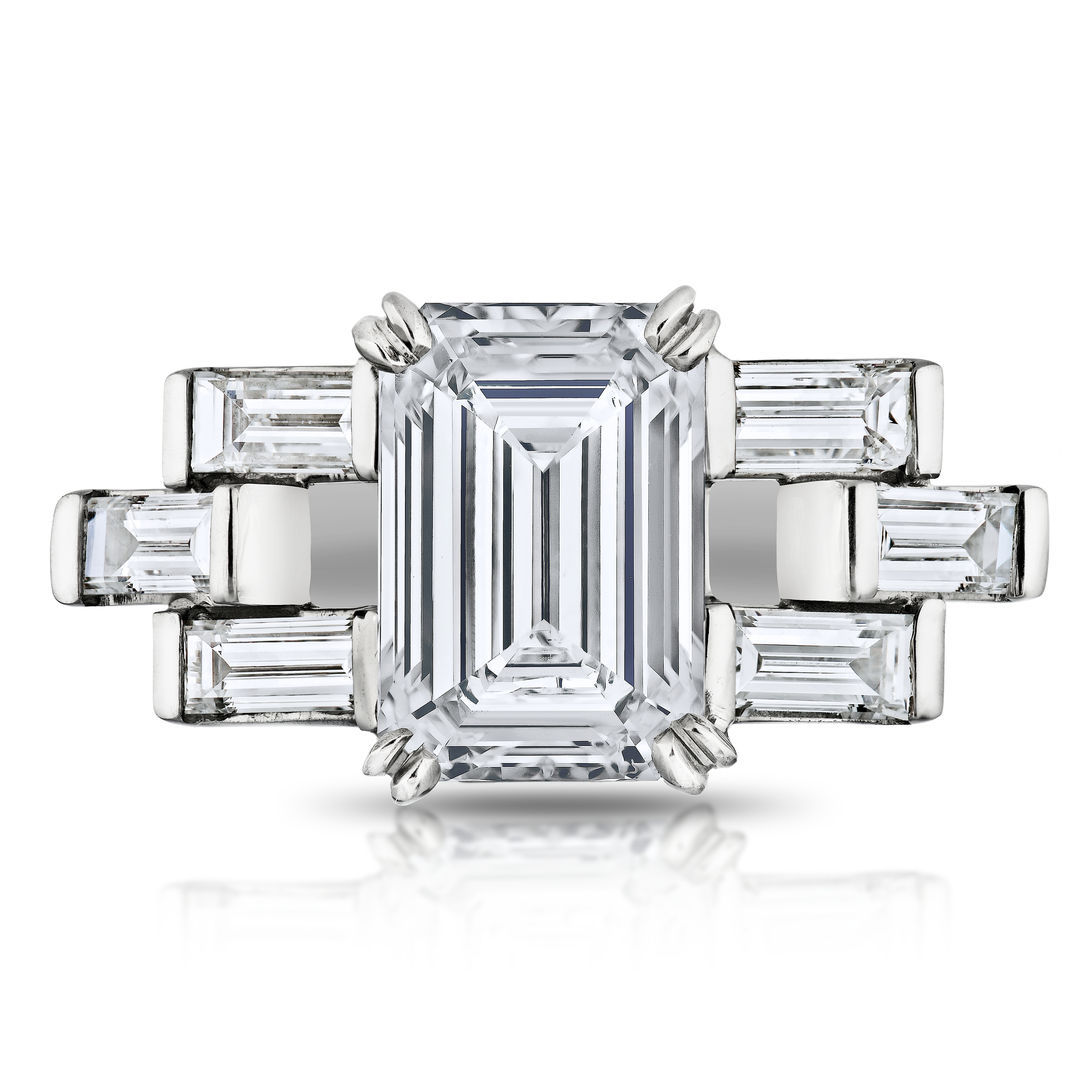 TRILOGY RING WITH EMERALD CUT CENTER DIAMOND AND SIX BAGUETTE CUT SIDE DIAMONDS, CRAFTED IN PLATINUM,  3.45 CTW