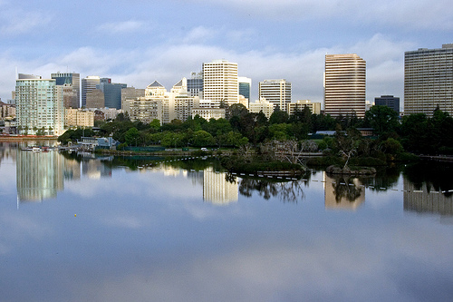 view of Lake merritt with In Touch Realty Services office building in backgroung