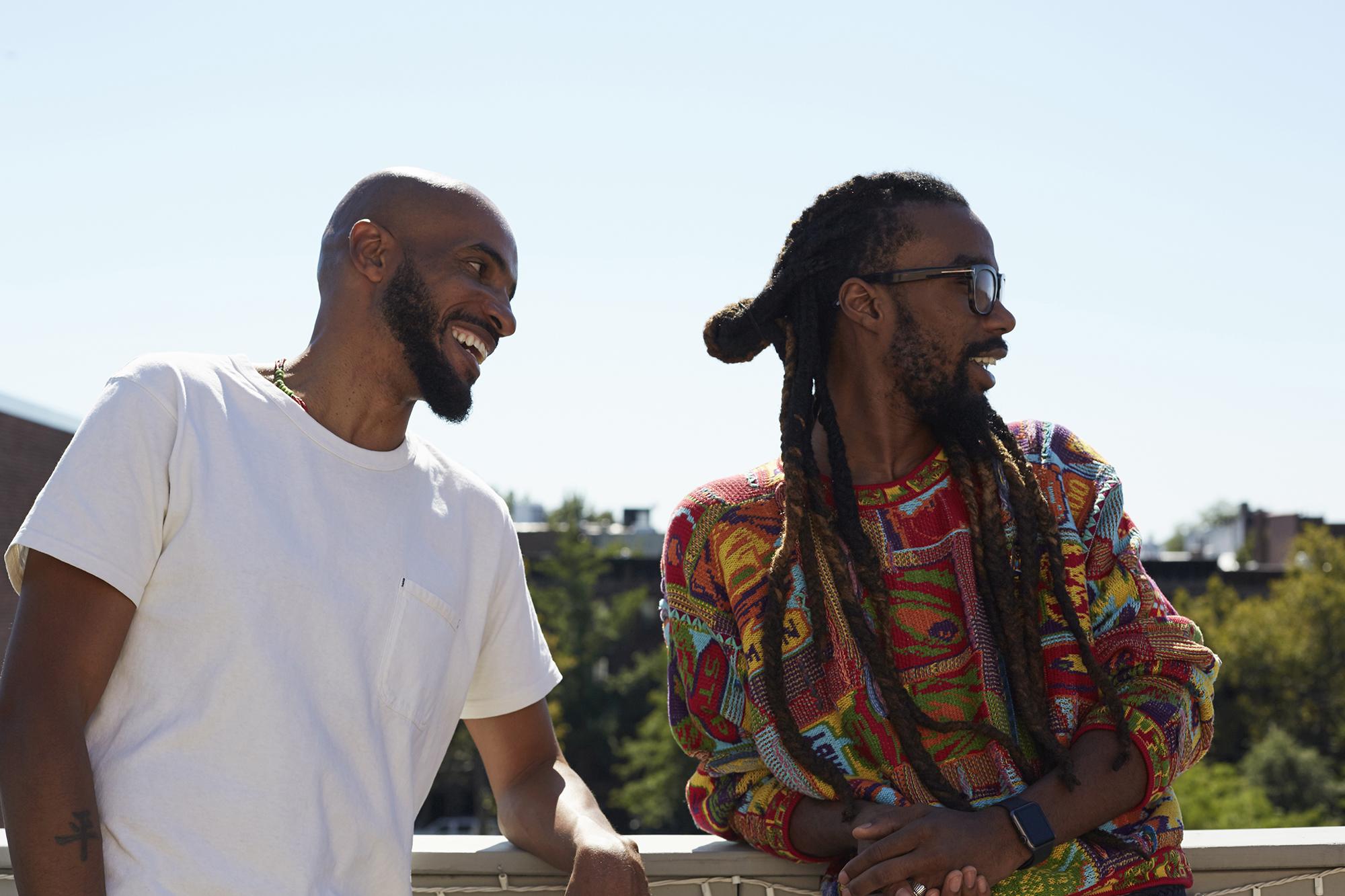 Julian and Yahdon share a laugh on Julian's balcony.