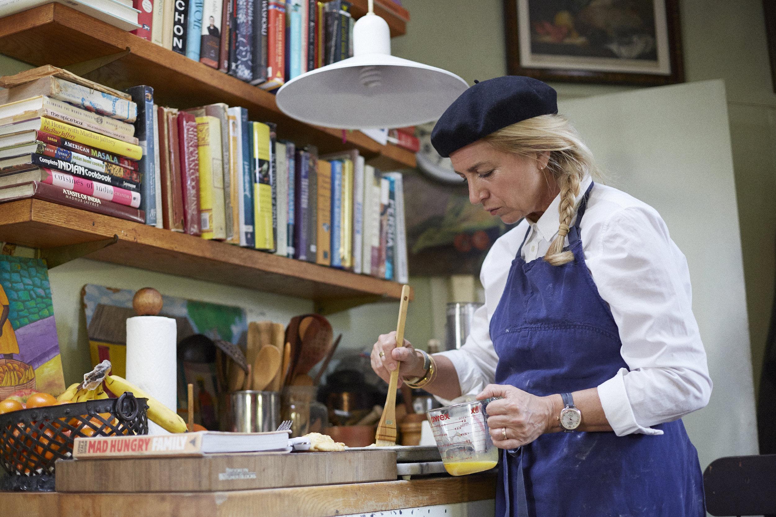 Lucinda prepares apple pocket pies in her kitchen.