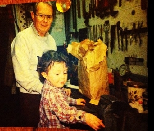 Allan as a kid with his paternal grandfather in his workshop.