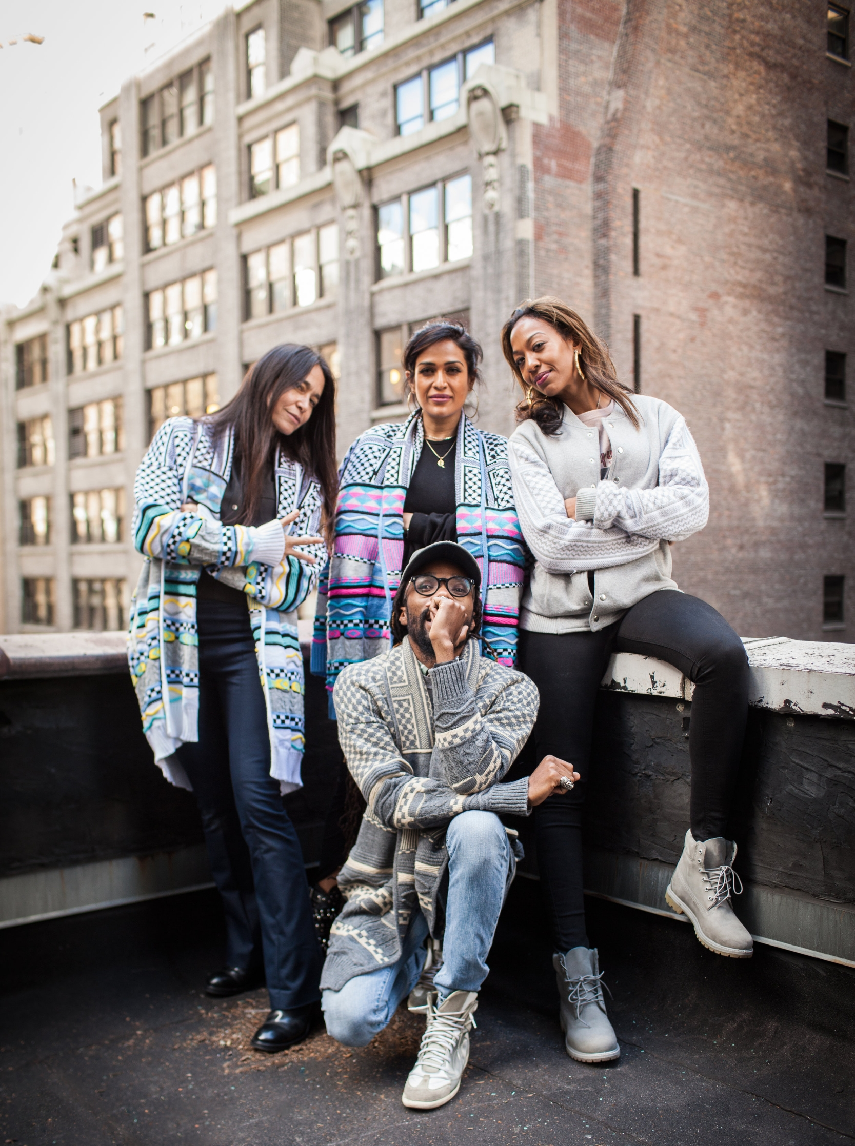 Founder Jill Andresevic,Ainy,Sari, and Yahdon posing in ANZ on city rooftop.