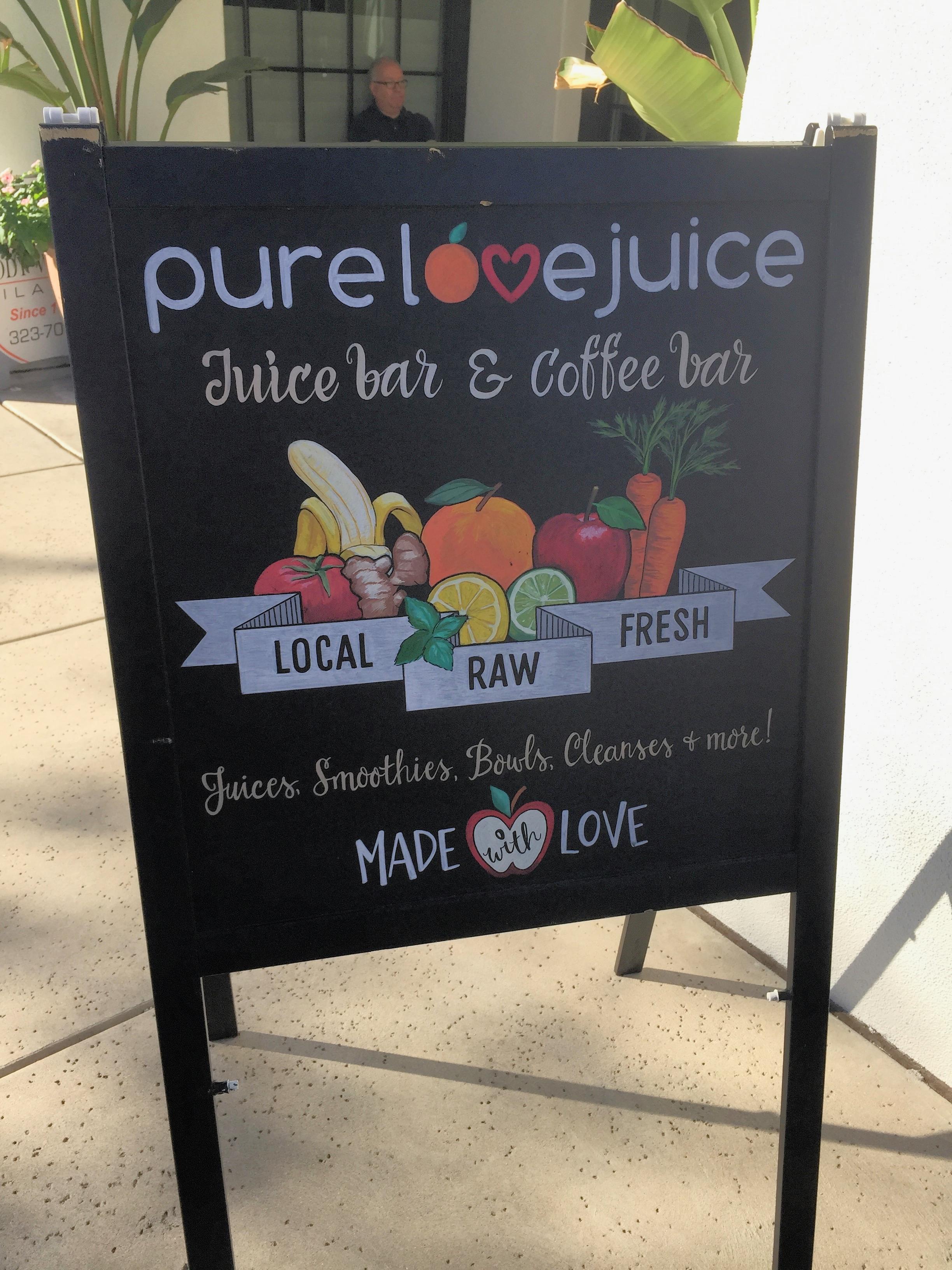 Juice Bar Pure Love Juice on 1980 East River Road, Tucson, Az is located below a pilates studio.