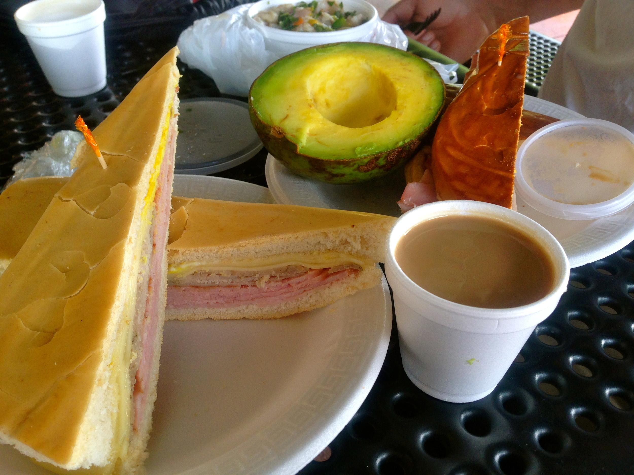 Media noche sandwich, cuban sandwich,huge avocados and cuban coffee, cortadito at the Palacio de los jugos.