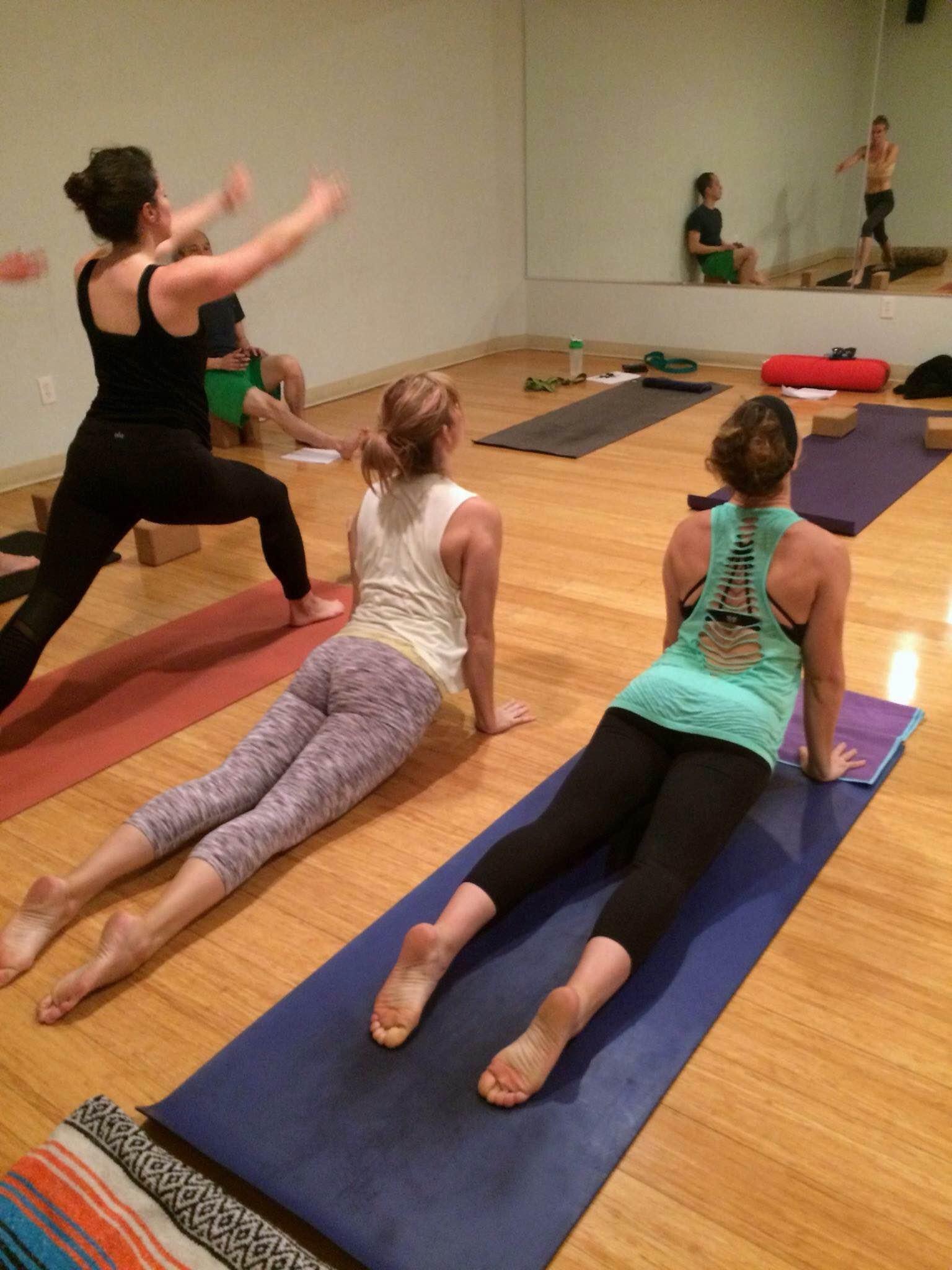 Adrea teaching her first yoga class.
