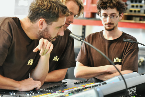 Corin Harper, prepping a Midas digital console for a show, explains a few features to Josh.