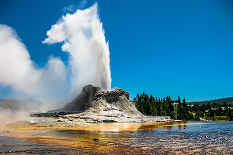 Steamboat Geyser blasting steam and water into the air - Yellowstone Guided Tours - Wyoming Guide Co