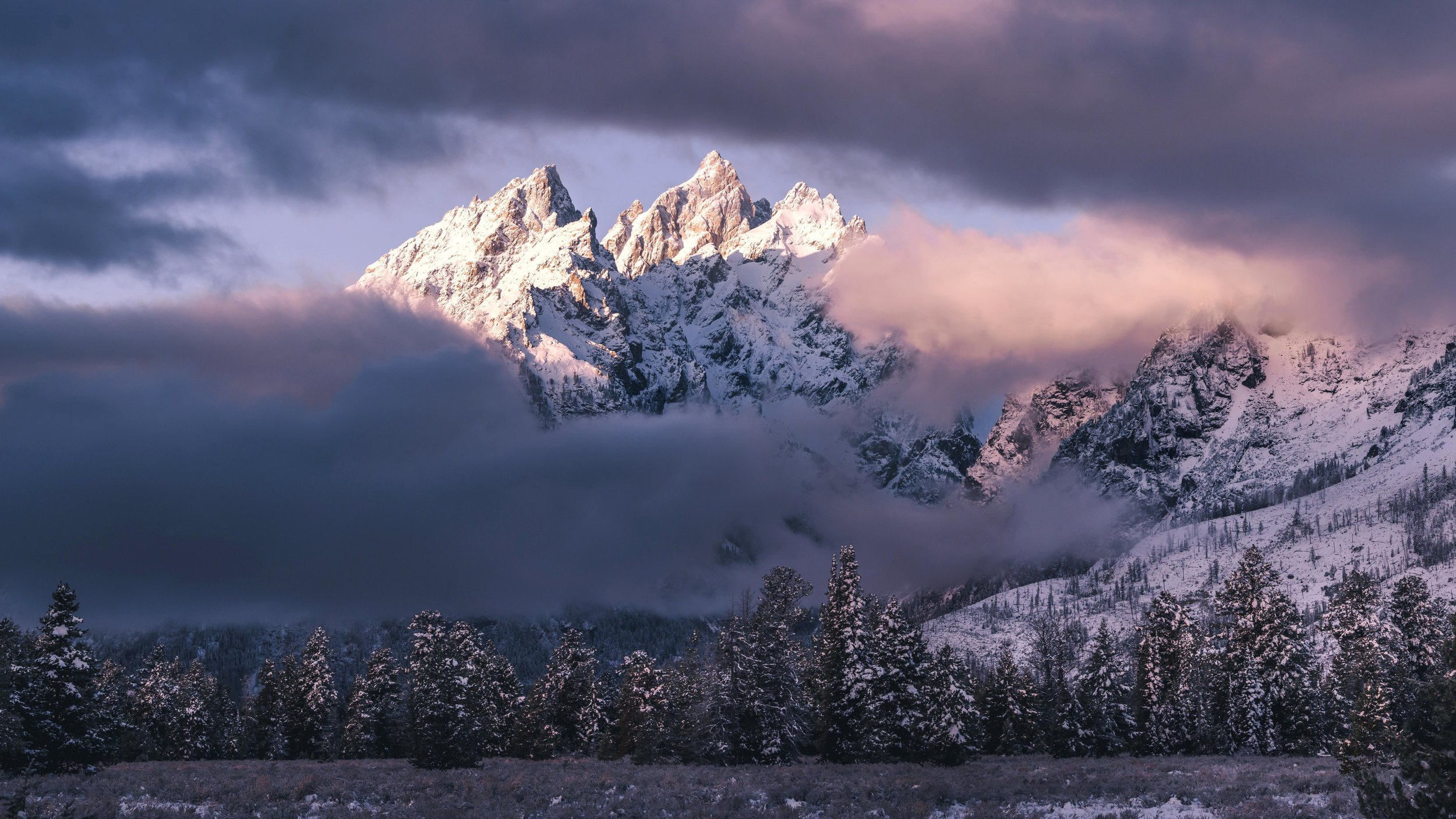 grand teton national park peeking through the clouds.jpg