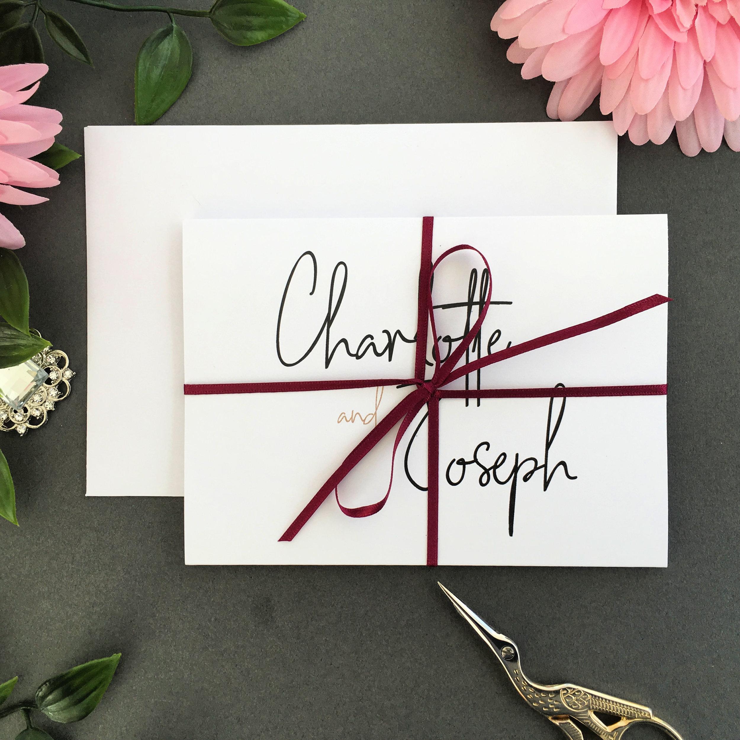 Chancery Lane concertina invitation shown with Burgundy ribbon tie
