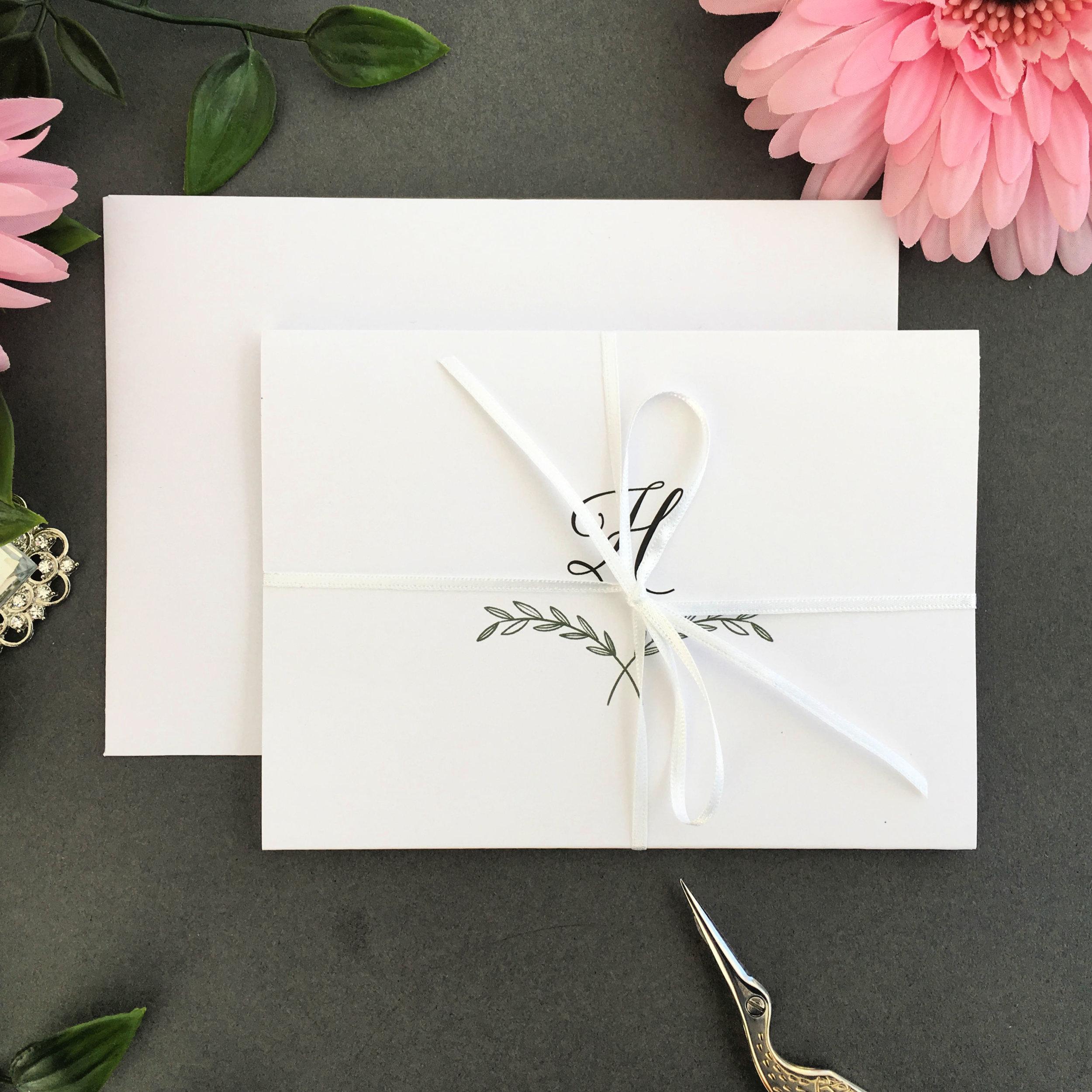 Paddington concertina invitation shown with White ribbon tie
