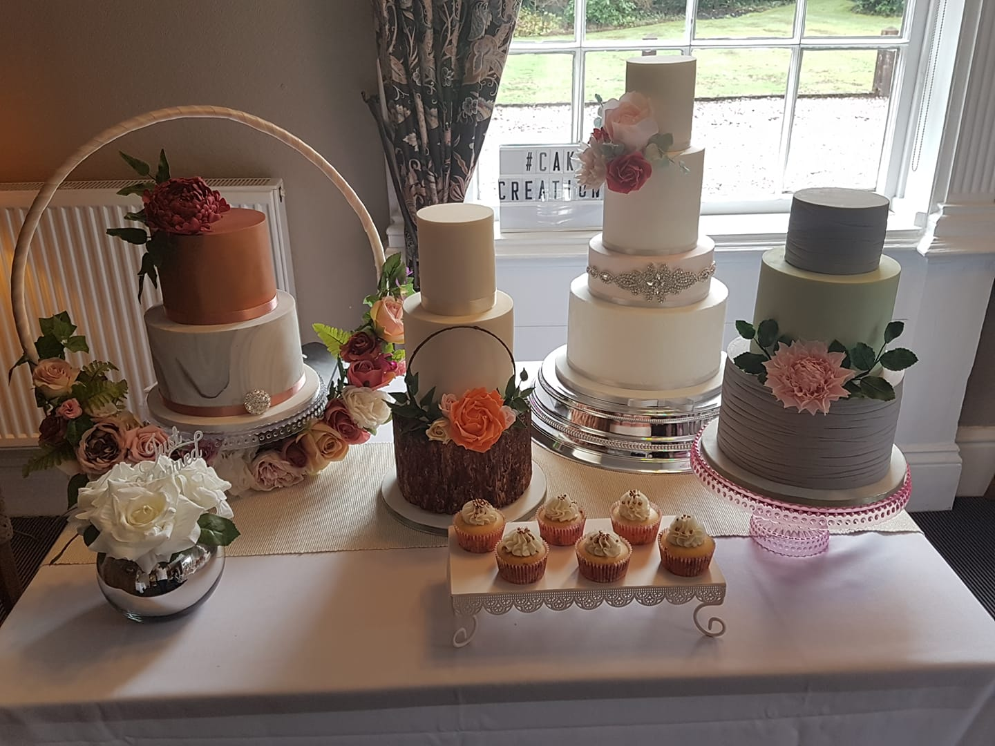 Cake Creations - Absolutely stunning work on show from Dawn at Cake Creations. And those little cupcakes you can see in the picture; we had one of them and were quickly wanting more!Beautiful, intricate work and a lovely personality to boot - what more could you want?!