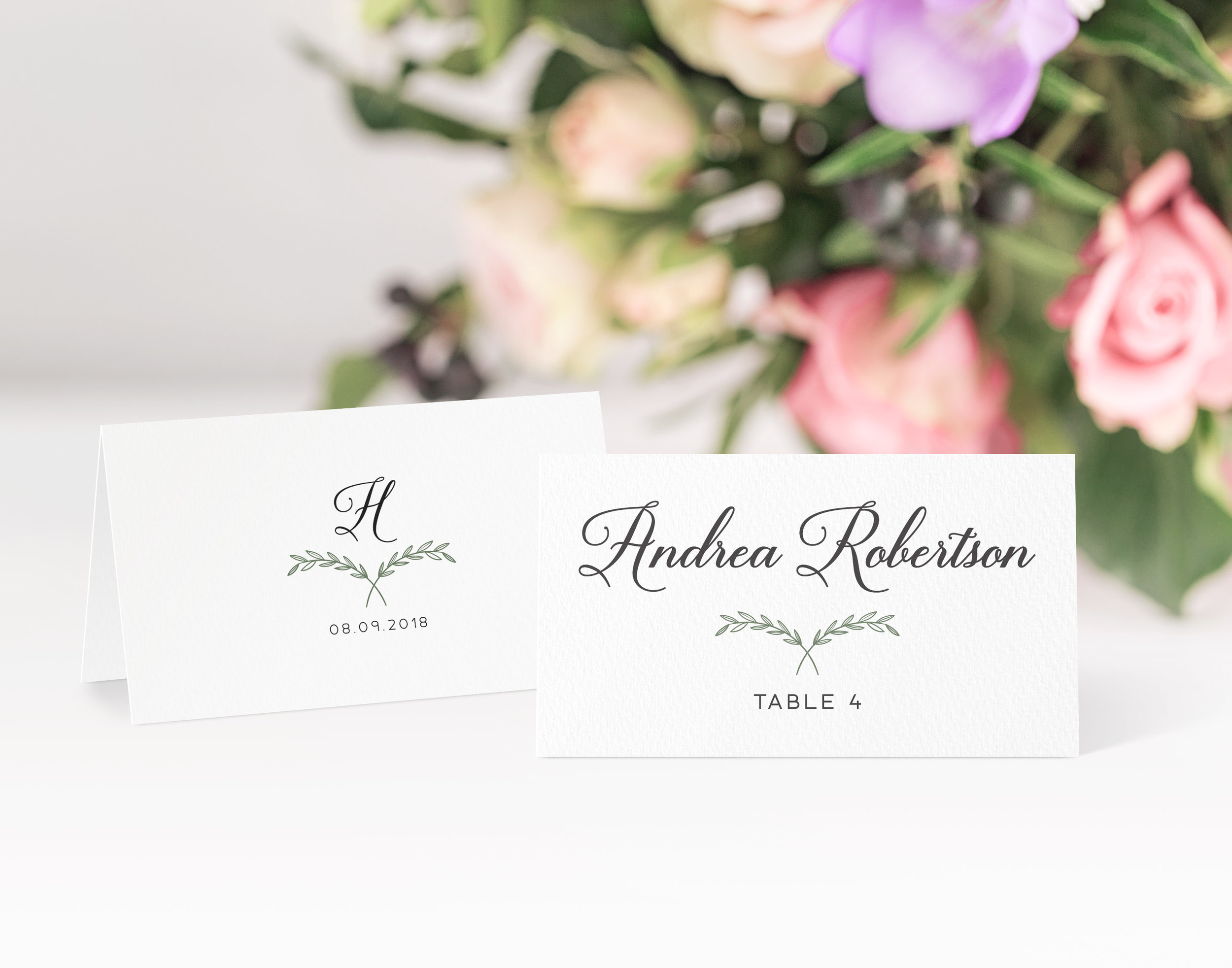 Paddington - A subtle laurel wreath is used on both the front and back of this place card; an initial of the wedded surname is used on the reverse, with a lovely script font used on the front for guest names.Our place cards are printed and then scored ready to be folded and placed onto your tables on the big day. Personalisation can be extended to menu choices on the reverse too.Pricing£0.80 each