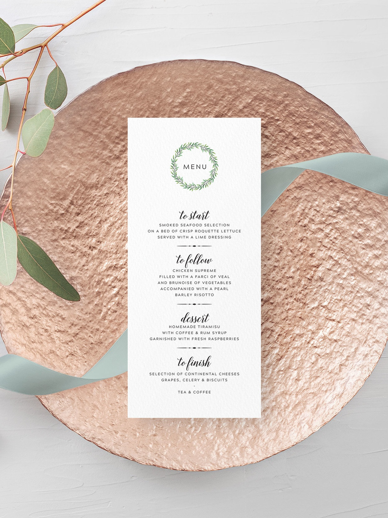Mansion House - A delicate foliage wreath is used with contemporary typography for this lovely menu card design.Our menu cards can be printed single- or double-sided, and can double as place cards by having them personalised with a guest name too.Pricing£1.15 - standard, single-sided / £1.65 - personalised, single-sided£1.40 - standard, double-sided / £1.90 - personalised, double-sided