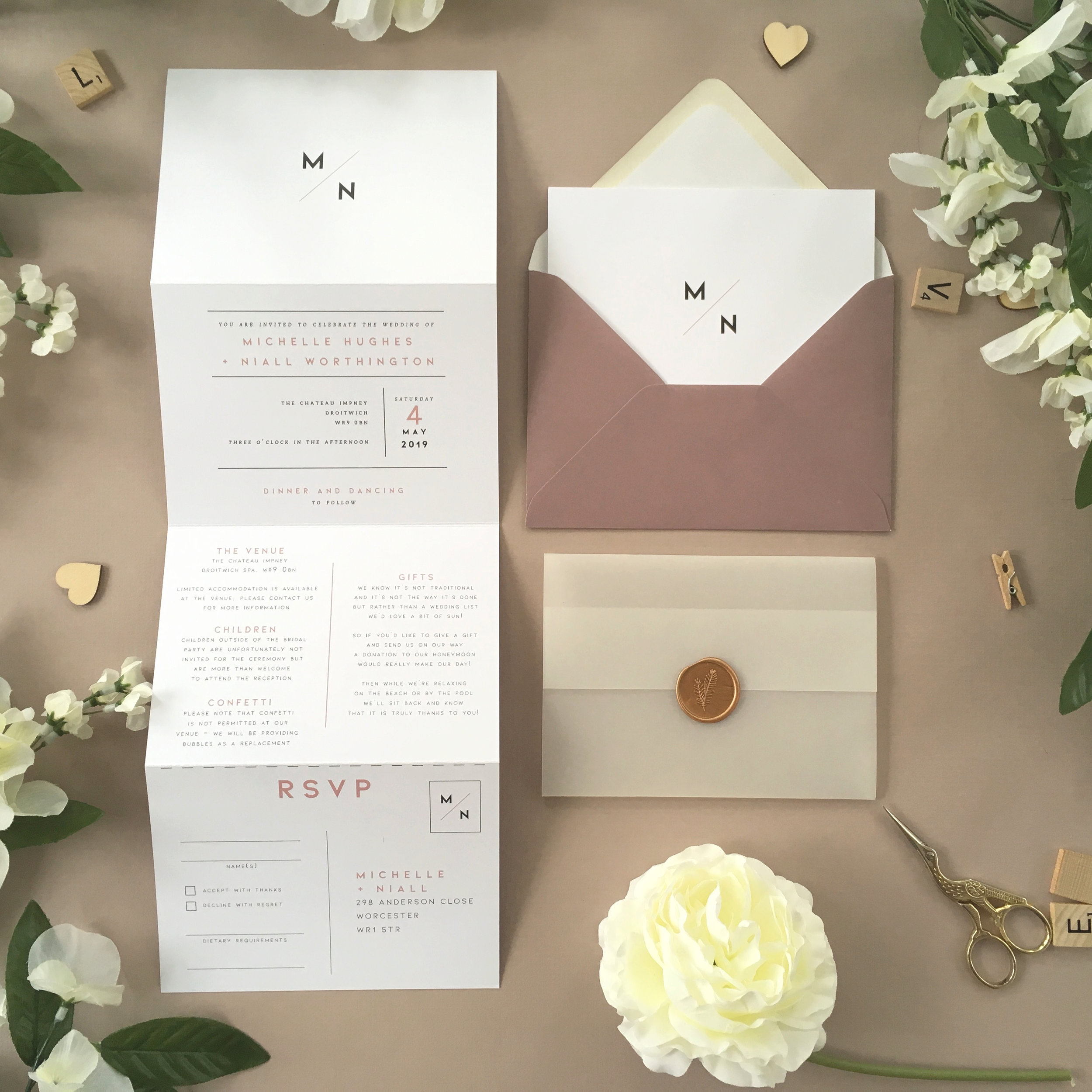 Camden - A striking minimalist design is used for our Camden collection, with bold typography and an insignia bearing the couple's initials.Our concertina invitations are a great all-in-one solution, with a detachable RSVP at the bottom of the invitation - all guests need to do is fill in their details, put a stamp in the corner and post!Concertina invitations can be provided on an as-is basis, or can be provided bound with a vellum jacket and timeless wax seal, or tied with ribbon or twine for a lovely hand-finished approach.- Concertina Invitation - from £1.95- Ribbon or Twine - £0.40- Vellum Jacket - £0.40- Wax Seal - £0.85 (Custom engraving also available)White envelope provided as standard with coloured upgrade available.
