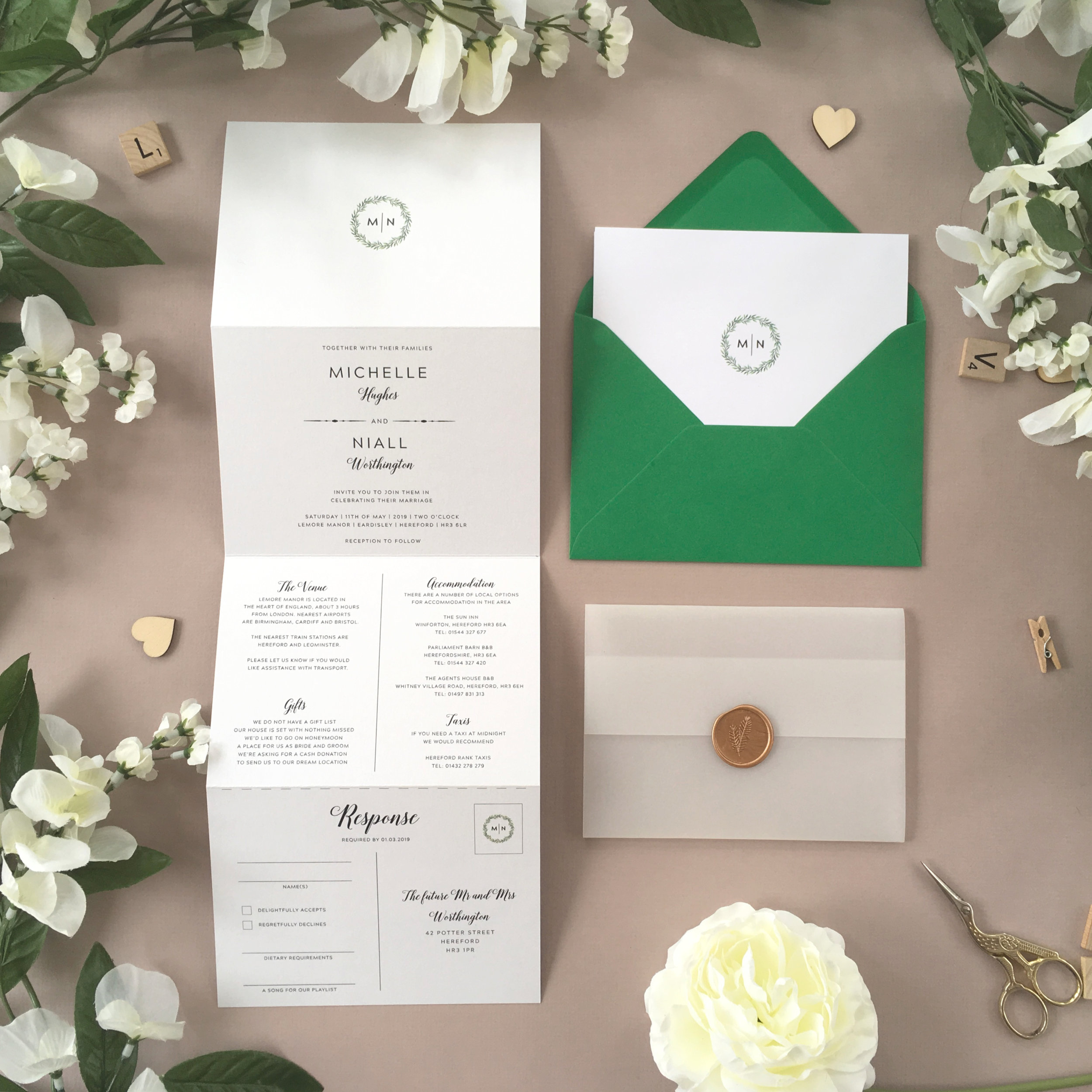 Mansion House - Simple and minimalist with a delicate foliage wreath wrapped around the happy couple's initials, this concertina invitation from our Mansion House collection is a stylish invitation option.Our concertina invitations are a great all-in-one solution, with a detachable RSVP at the bottom of the invitation - all guests need to do is fill in their details, put a stamp in the corner and post!Concertina invitations can be provided on an as-is basis, or can be provided bound with a vellum jacket and timeless wax seal, or tied with ribbon or twine for a lovely hand-finished approach.- Concertina Invitation - from £1.95- Ribbon or Twine - £0.40- Vellum Jacket - £0.40- Wax Seal - £0.85 (Custom engraving also available)White envelope provided as standard with coloured upgrade available.