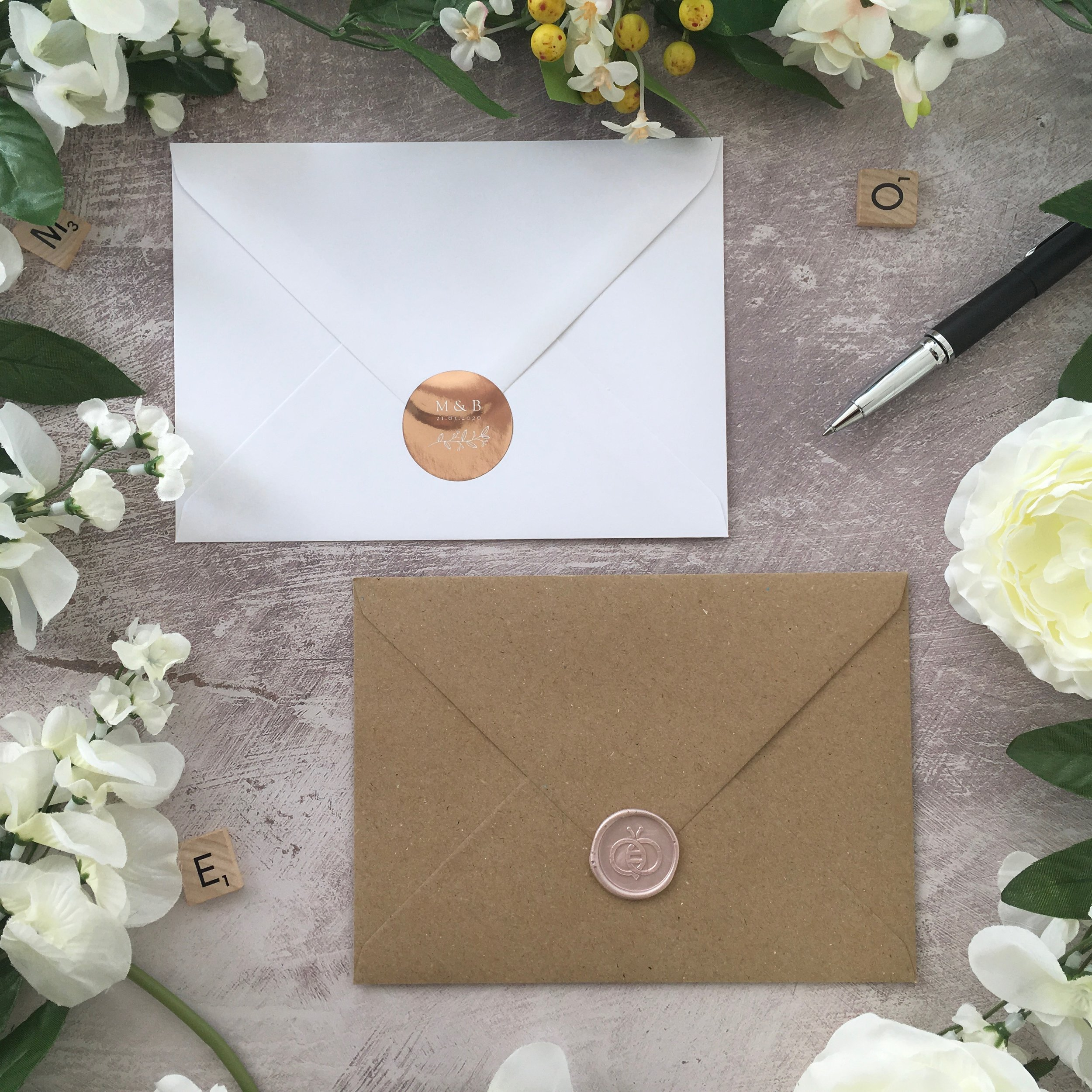 Stickers & Wax Seals - Whilst stickers and wax seals are used to seal a vellum jacket, they are also a beautiful addition to sealing your envelopes.Stickers are available in gold, silver or rose gold with the design matching your invitation design, bearing your details.Wax seals are meticulously hand-pressed and are available in a number of house designs and colours, or you can opt for a personalised etching to create your self-adhesive seals.