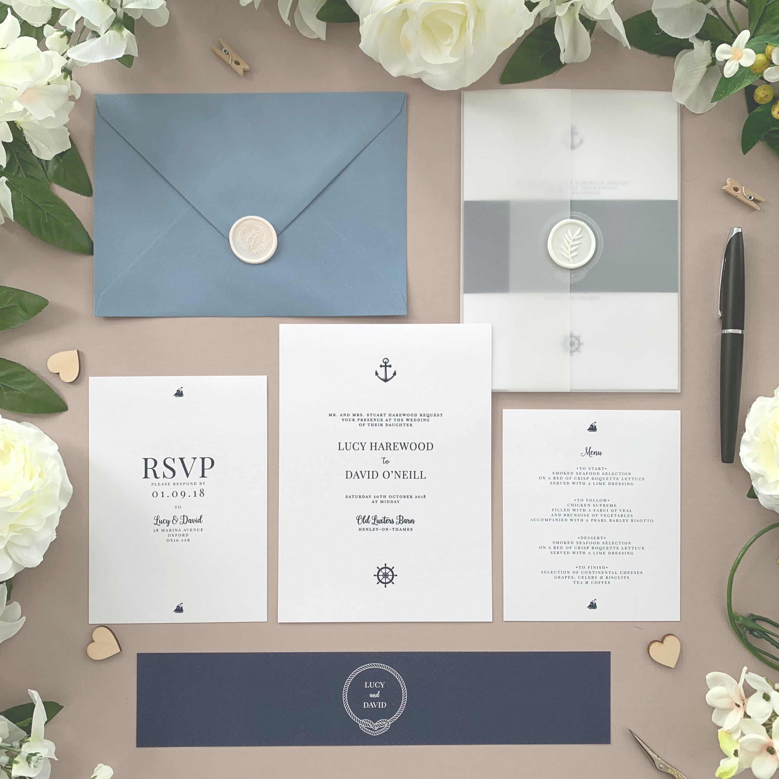 Canary Wharf - Iconic nautical imagery and a classical navy colour scheme make this classic wedding invitation suite from our Canary Wharf collection a beautiful option for your seaside-themed wedding.The classic invitation suite is our most popular configuration and hugely versatile. If you don't have much to say or want to keep things simple you can even just order the invitation card on its own, which is an ideal option for evening guests.Most couples opt for a suite of items for day guests which can then be bound, with a choice of a paper belly band, vellum jacket, sticker or wax seal to keep multiple cards beautifully neat and together.Coloured envelopes are available, in addition to printing of guest names and envelopes to make the process even easier.