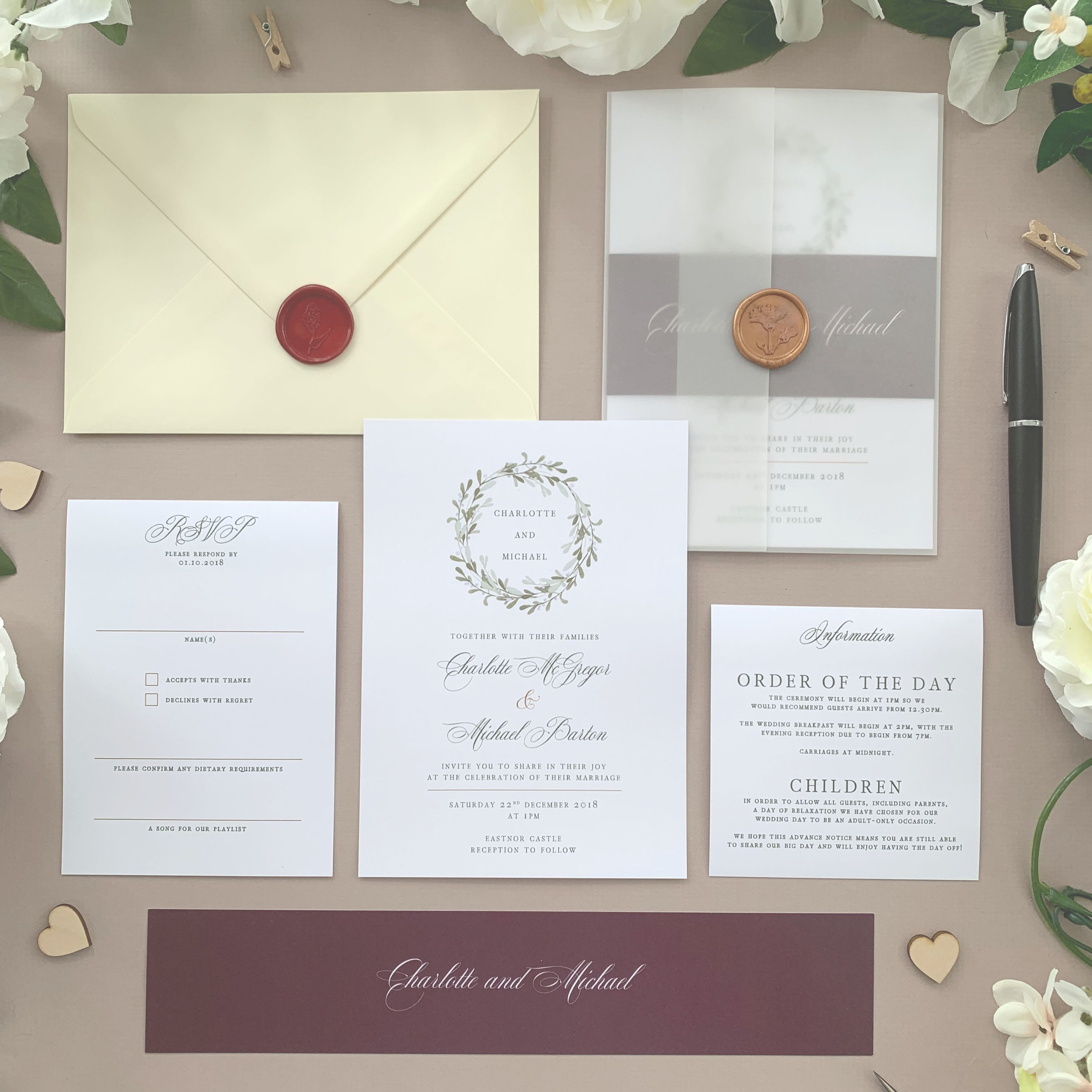 Oxford - Using classical typography alongside a beautiful Christmas wreath, this classic wedding invitation suite comes from our wintry Oxford collection.The classic invitation suite is our most popular configuration and hugely versatile. If you don't have much to say or want to keep things simple you can even just order the invitation card on its own, which is an ideal option for evening guests.Most couples opt for a suite of items for day guests which can then be bound, with a choice of a paper belly band, vellum jacket, sticker or wax seal to keep multiple cards beautifully neat and together.Coloured envelopes are available, in addition to printing of guest names and envelopes to make the process even easier.