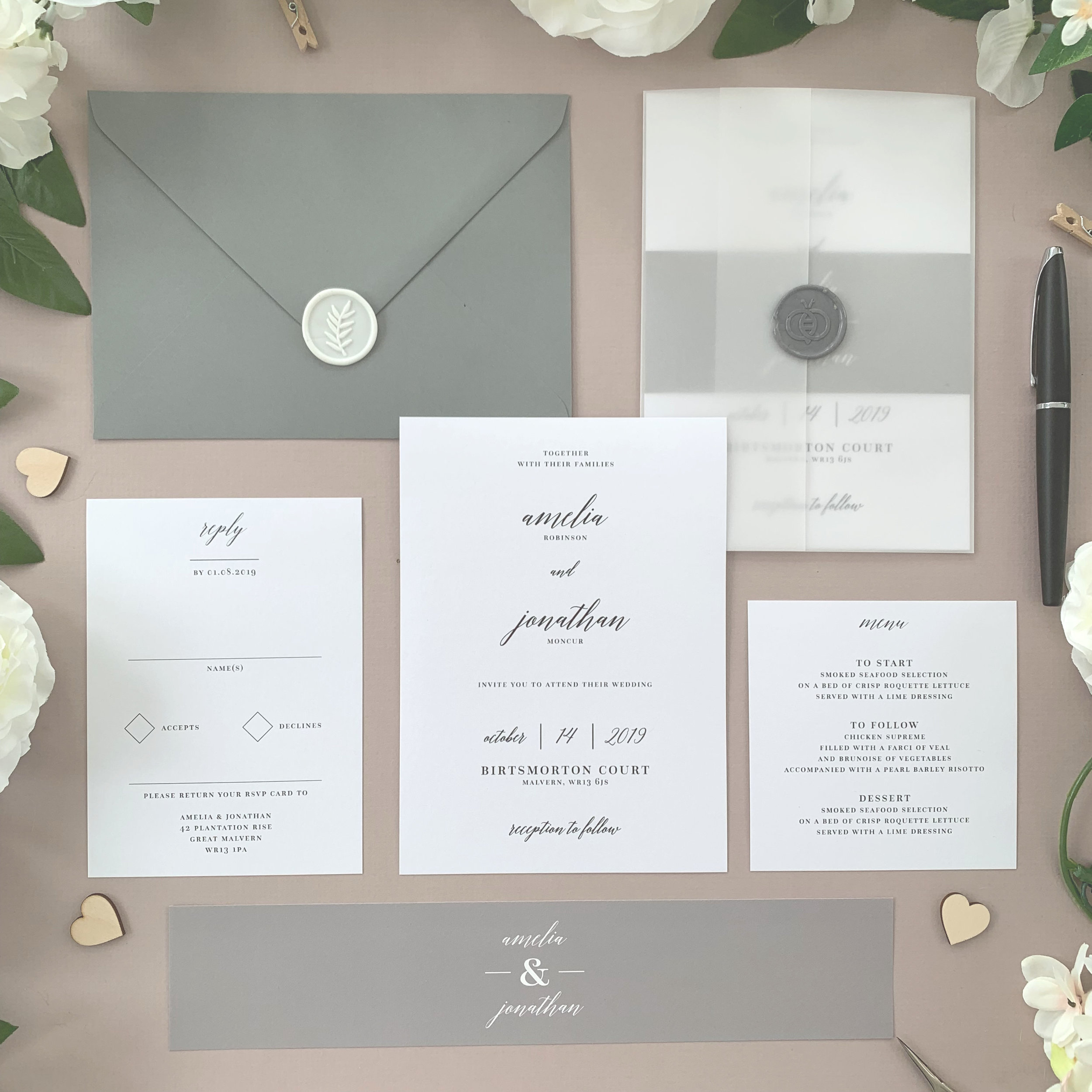 Westminster - Classical and understated, our Westminster collection is shown here in a muted invitation suite with a grey belly band and works beautifully in this form of colour scheme.The classic invitation suite is our most popular configuration and hugely versatile. If you don't have much to say or want to keep things simple you can even just order the invitation card on its own, which is an ideal option for evening guests.Most couples opt for a suite of items for day guests which can then be bound, with a choice of a paper belly band, vellum jacket, sticker or wax seal to keep multiple cards beautifully neat and together.Coloured envelopes are available, in addition to printing of guest names and envelopes to make the process even easier.