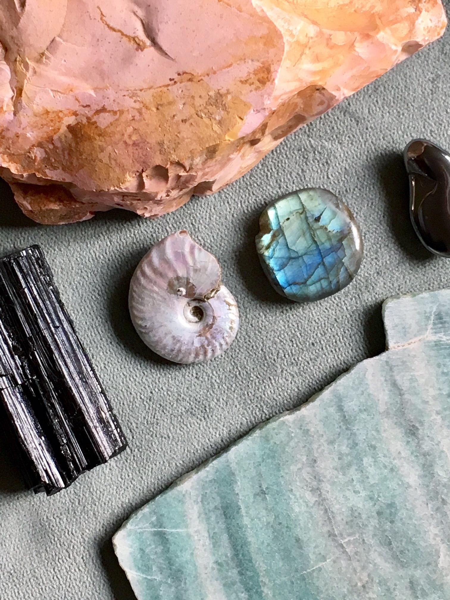 Pink opal, black tourmaline, ammonite, labradorite, hematite, and aventurine