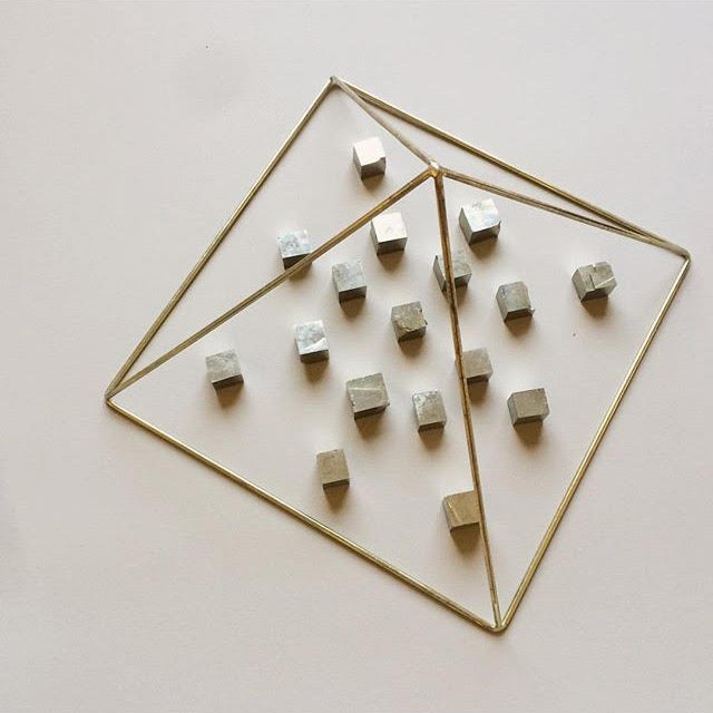 Pyrite cubes charging under golden pyramid