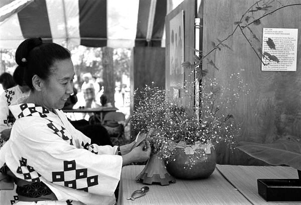 Atsuko Lefcourte demonstrating Ikebana flower arranging at the 1988 Florida Folk Festival