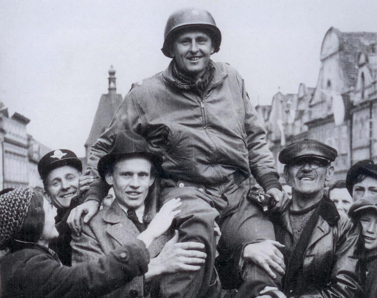 Matt Konop carried by townspeople of Domazlice, Czechoslovakia, 1945.