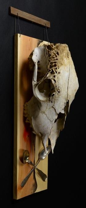 "Skull and Cross Spoons. H: 28""  Skull,  Spoons, Wood, Paint, Ceramic, Paper."