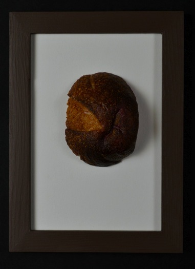 "Avoidance. H: 8""  Encaustic on Bread."