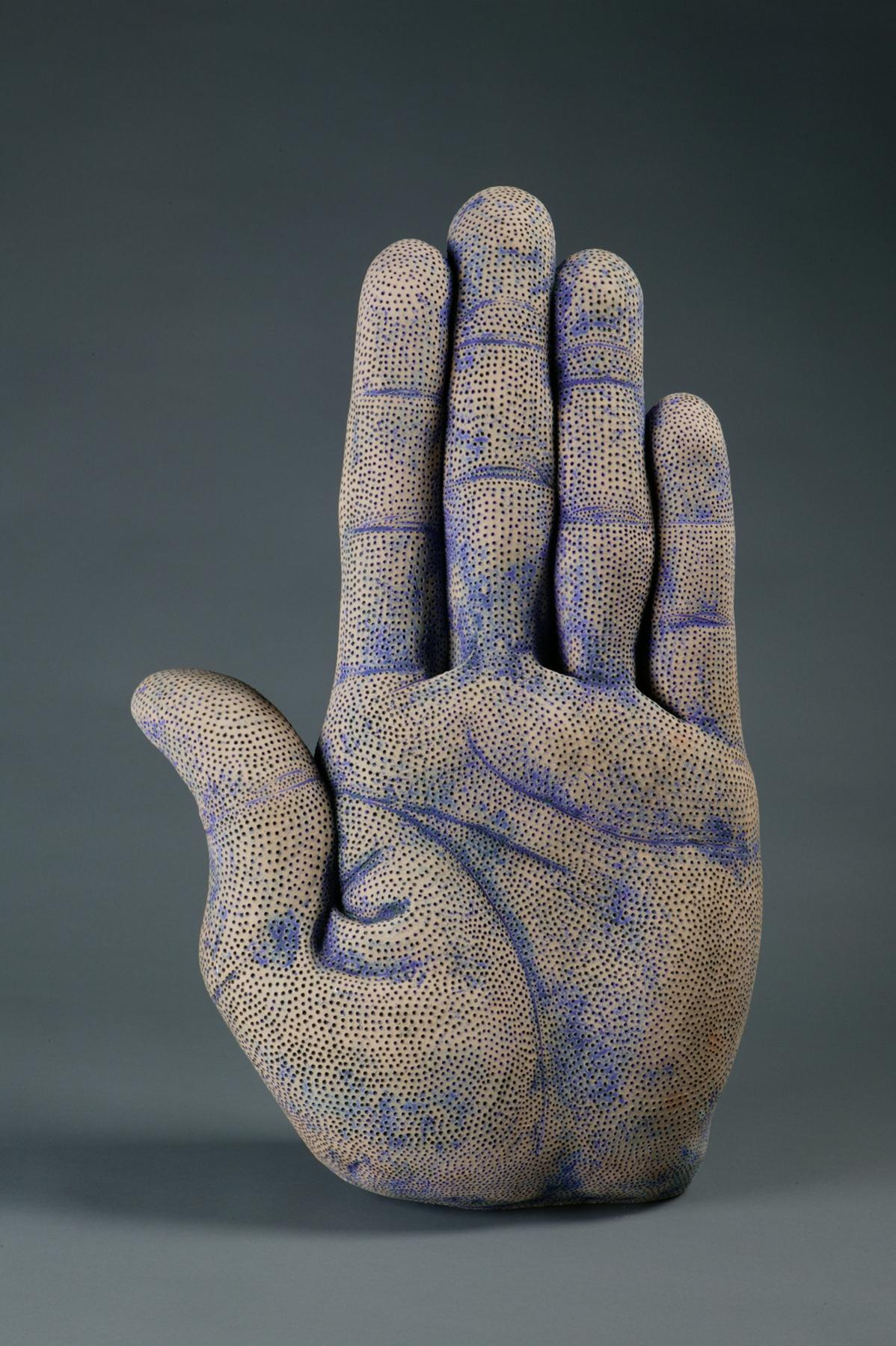 "Hand with 20,000 Holes. H: 31"" Low Fire Ceramic, Glaze."