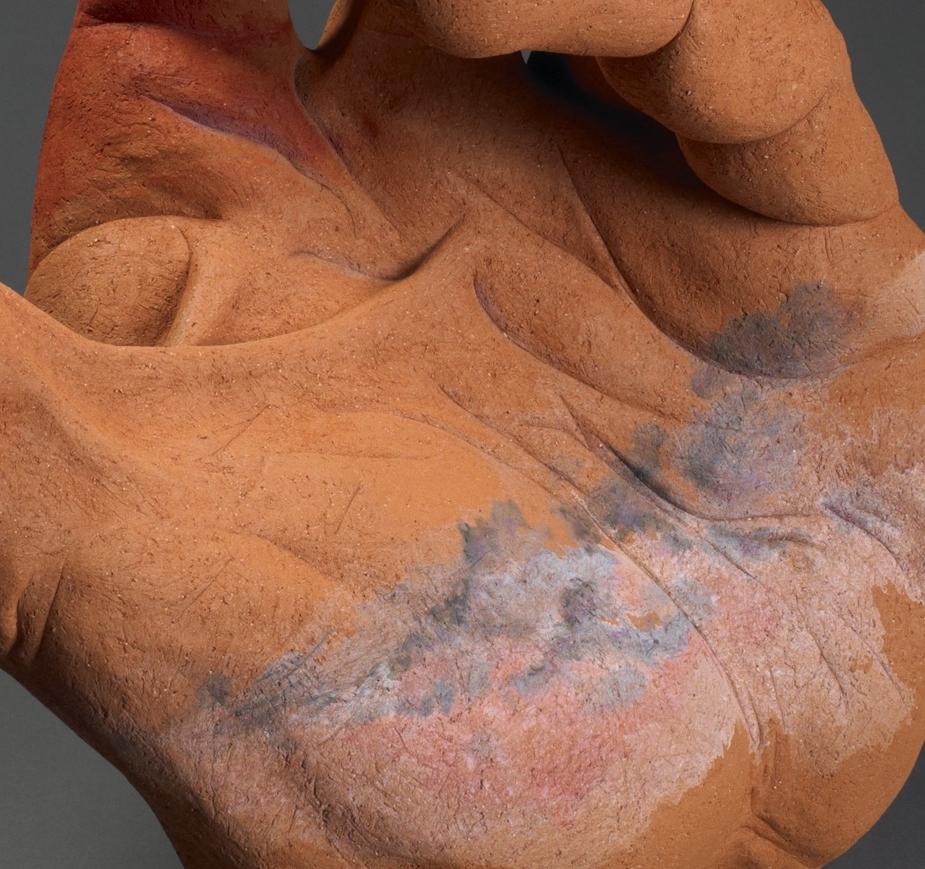 "Hand for High Plains. H: 24"" Terra Cotta, Acrylic Paint."