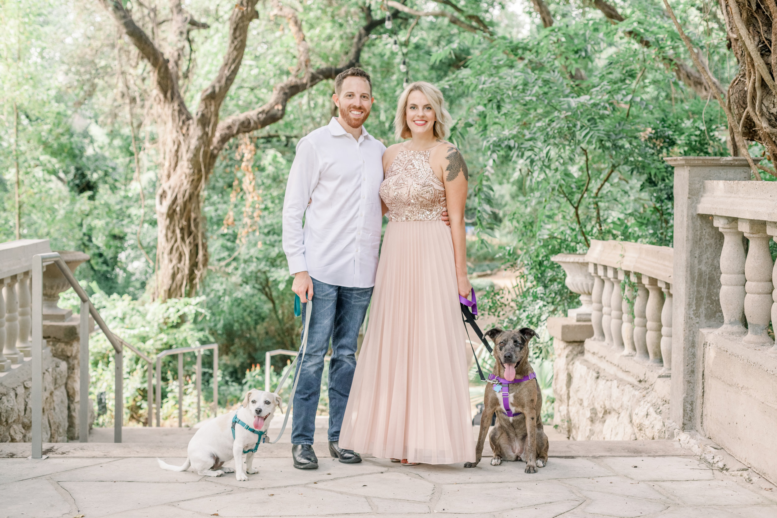Engaged couple with dogs at Laguna Gloria in Austin, Texas