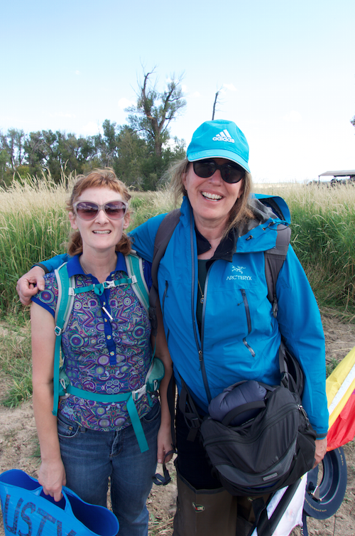 In the field: Necole with Dusty bucket and Tama with her kite.