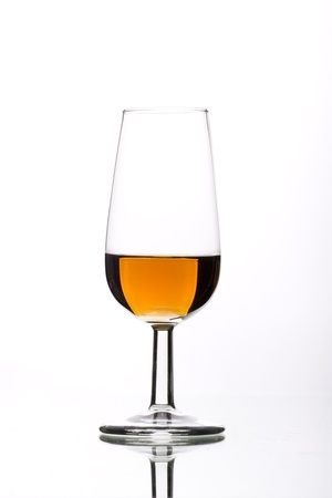 11766015-a-glass-of-wine-from-the-bottle-freshly-cast-Stock-Photo.jpg
