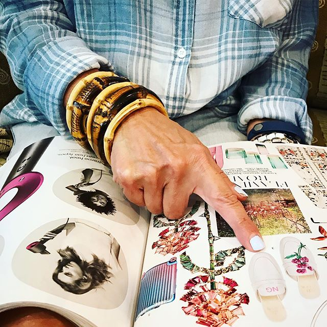 """#FashionbyFlotken: St. Louis Fashion Guru @wendyflotken browses """"NINA's EDIT"""" (@NinaGarcia) in the July issue of @elleusa. Wendy's wrist of bamboo bangles is an ode to @gucci & her nails are driftwood blue. 🌺 . . . . . . . #fashion #stlfashion #bangles #bamboobangles #bangle #fashionmag #fashionmagazine #ellemag #ellemagazine #ninagarcia #style #fashionista"""