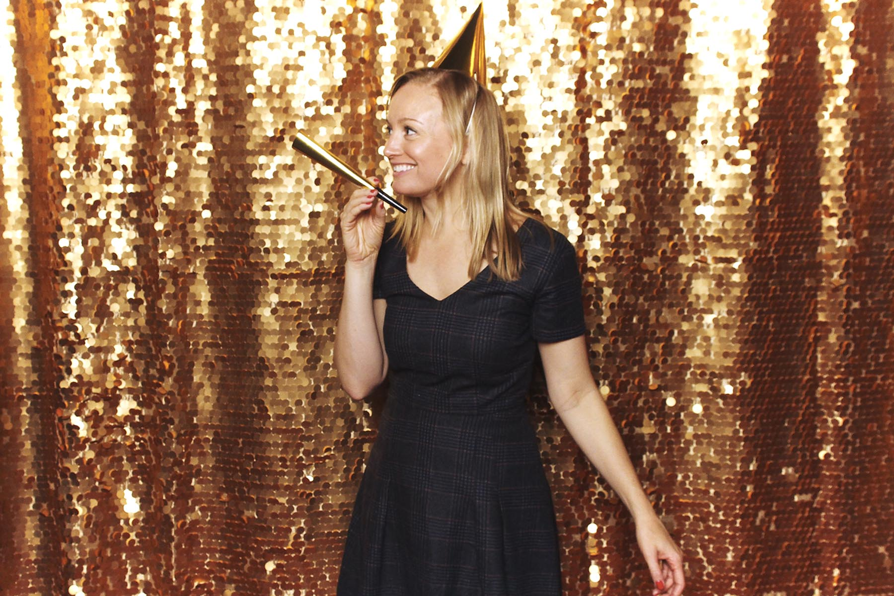 Our Festive Gold Sequin Backdrop is always a big hit!
