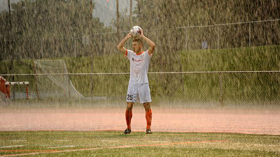 Juan Gatti plays through the extremely wet conditions at Dietz Stadium. (Photo by  Roy Gumpel )