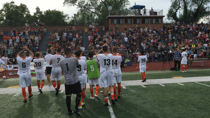Stockade players applaud the record home crowd after Sunday's win (photo by Nick Hoffay)