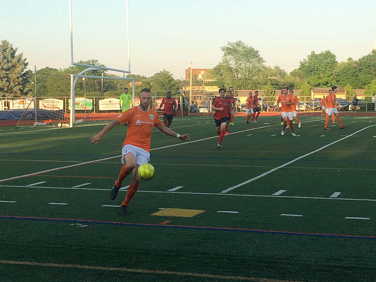 Michael Creswick collects the ball near the touchline for Stockade. (📷 StockadeFC.com)