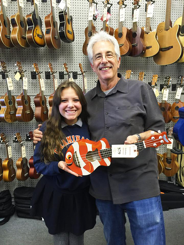 Heartstringz founder Natalie with George Kaye and a sweet clown fish ukulele!