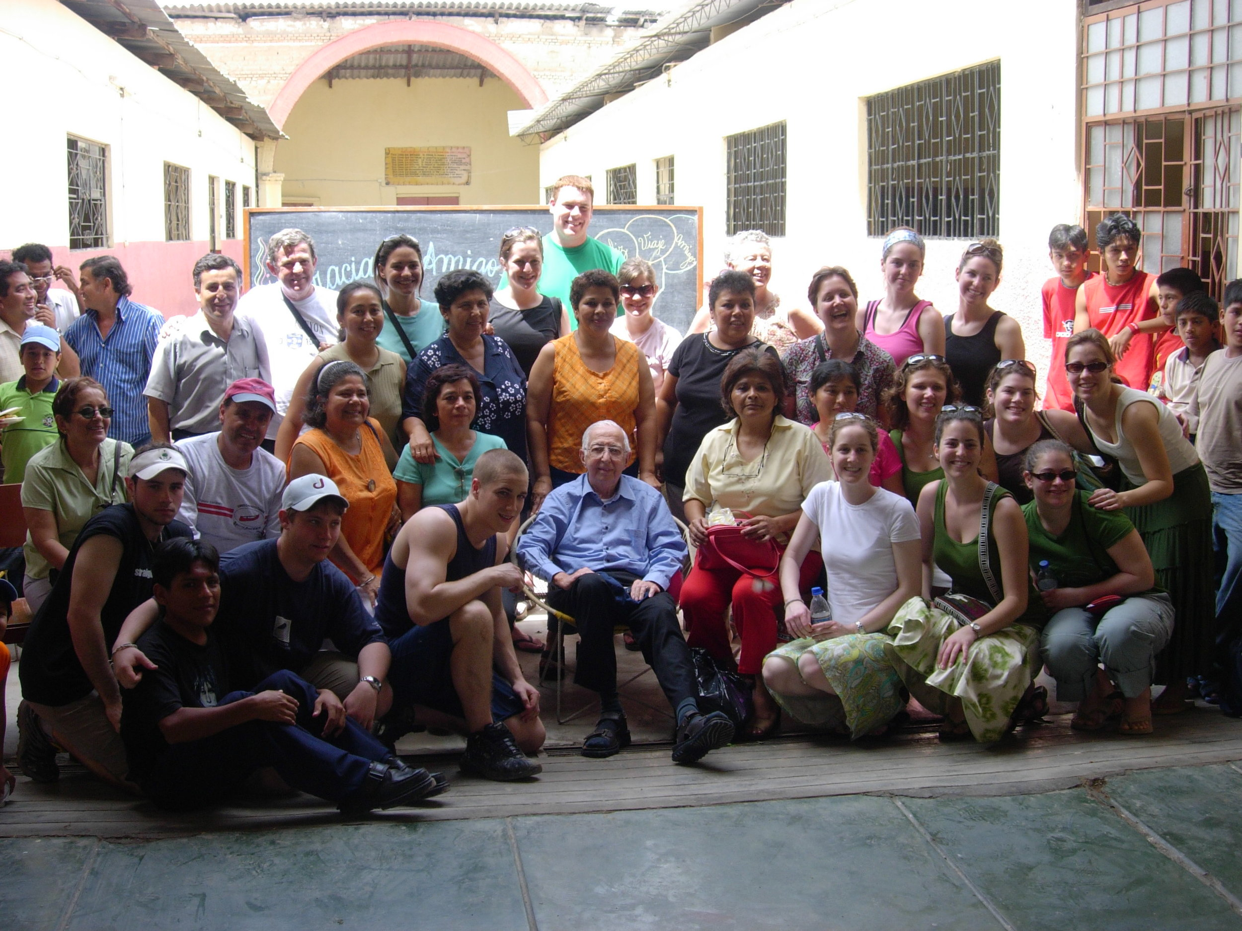Fifth- Fr. Appicci with volunteers after a day of painting and repairs at a school..JPG