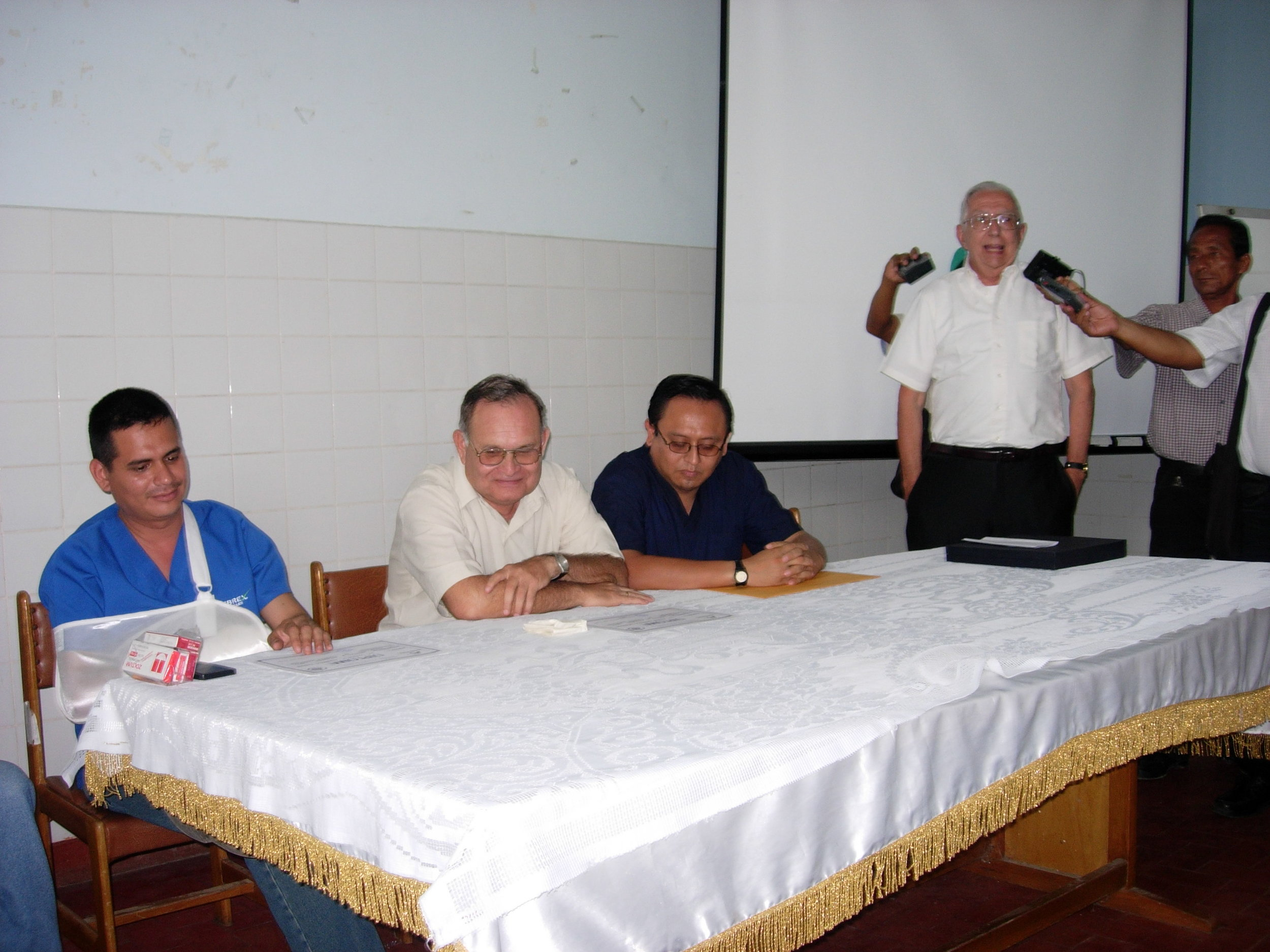 Fr. Appicci efforts included improving medical care. The gentleman on the far-left, was instrumental in buildingthe only medical facility in the Chulucanas..JPG