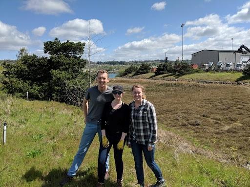 The Earth Economics team at Rhone Poulenc Salt Marsh in Tacoma: Jordan Wildish, Angela Fletcher, and Jean Jensen (left to right).