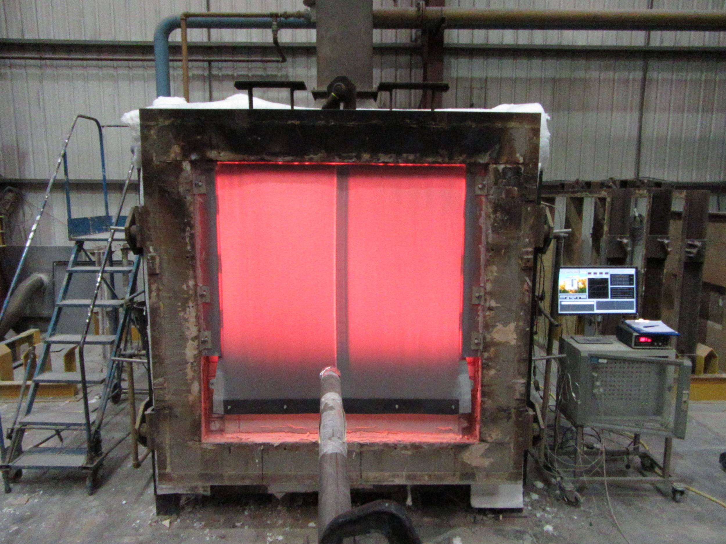 Small scale testing of the Kent Fire Curtain for oversize assessment