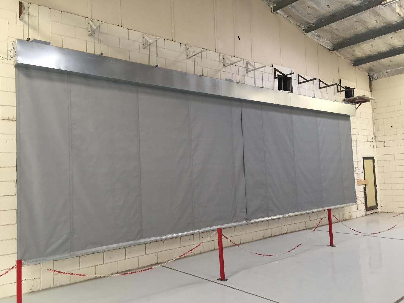 10m wide x 3m drop smoke curtain undergoing cycle testing to BS EN 12101-1:2006 Annex B